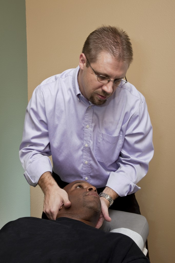 Therapist working on a neck - patient ethnic