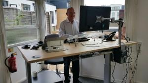 Stuart Blackman behind desk standing