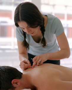 Acupuncturist with patient